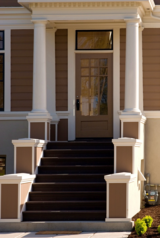 A grand entrance to a refurbished craftsman style home.