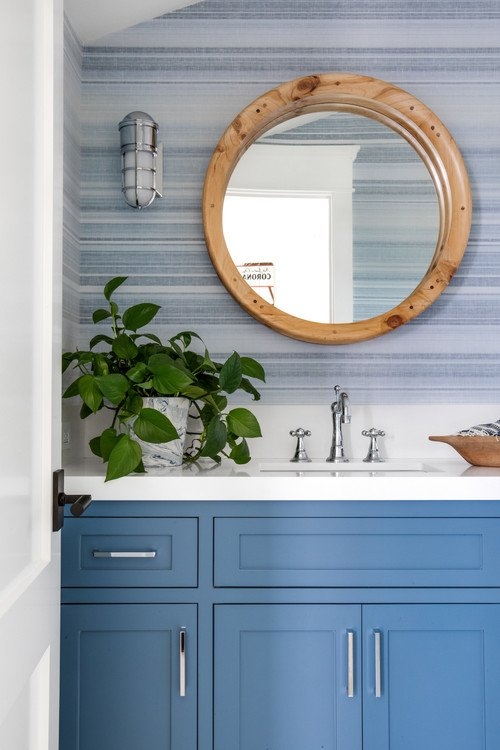 Cool Blue Bathroom with Subtly Striped Wallpaper
