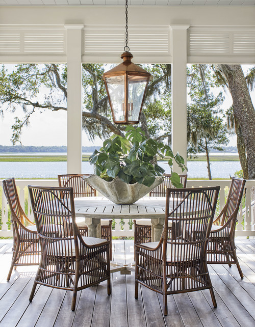 Porch Dining Area with Round Table and Rattan Chairs
