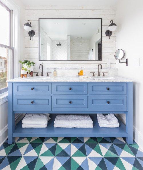 Light Blue Vanity and Geometric Patterned Floor
