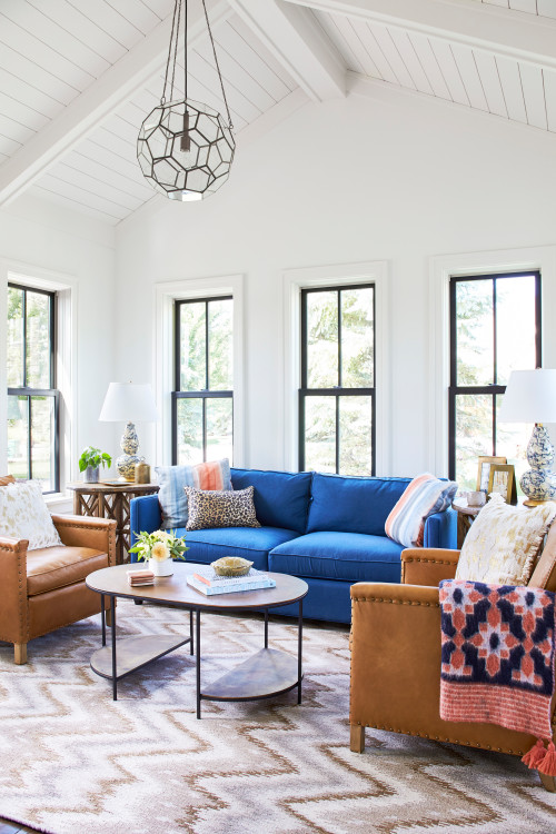 Blue and Tan Living Room in New Construction Farmhouse