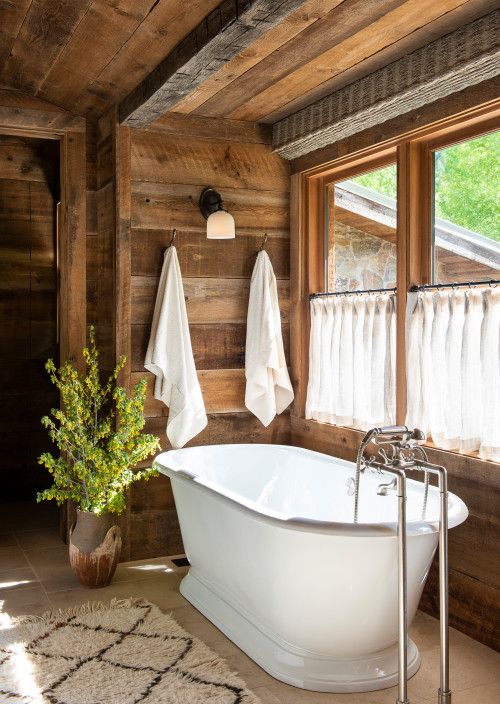 Rustic Bathroom with Rough Hewn Paneling and Standalone Tub