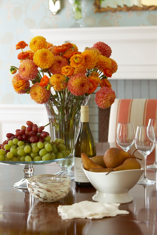 Orange and Peach Floral Centerpiece on Traditional Dining Table
