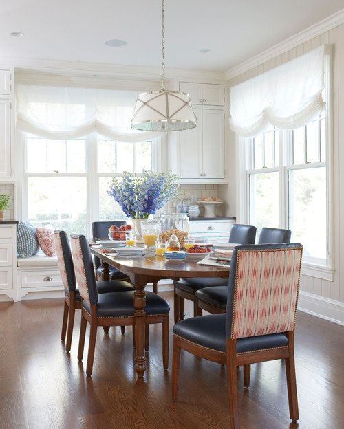 Light-Filled Eat-In Kitchen with Roman Shades and Leather Dining Chairs