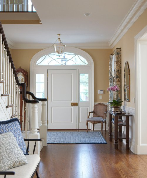 Traditional Entryway with Custom Staircase and Spiderweb Window