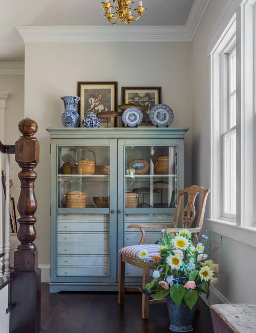 Traditional Hallway with Vintage Cabinet