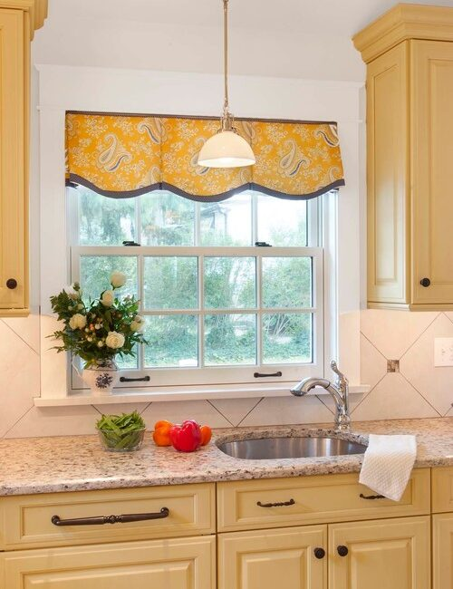 Sunny Cottage Kitchen with Yellow Cabinets