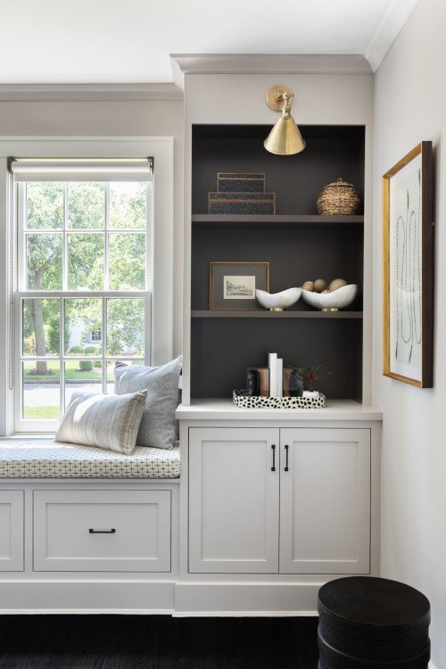 Built-In Bookshelves with Dark Interior Paint and Window Seat