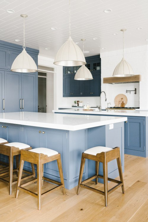 Blue-Gray Kitchen Cabinets and Wood Floor with Expansive Island