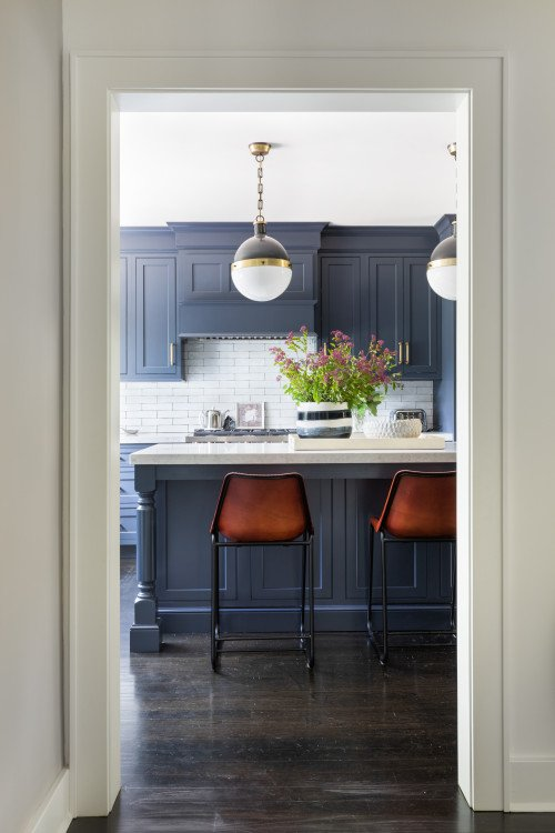Transitional Kitchen with Dark Blue Cabinets and Warm Wood Floors