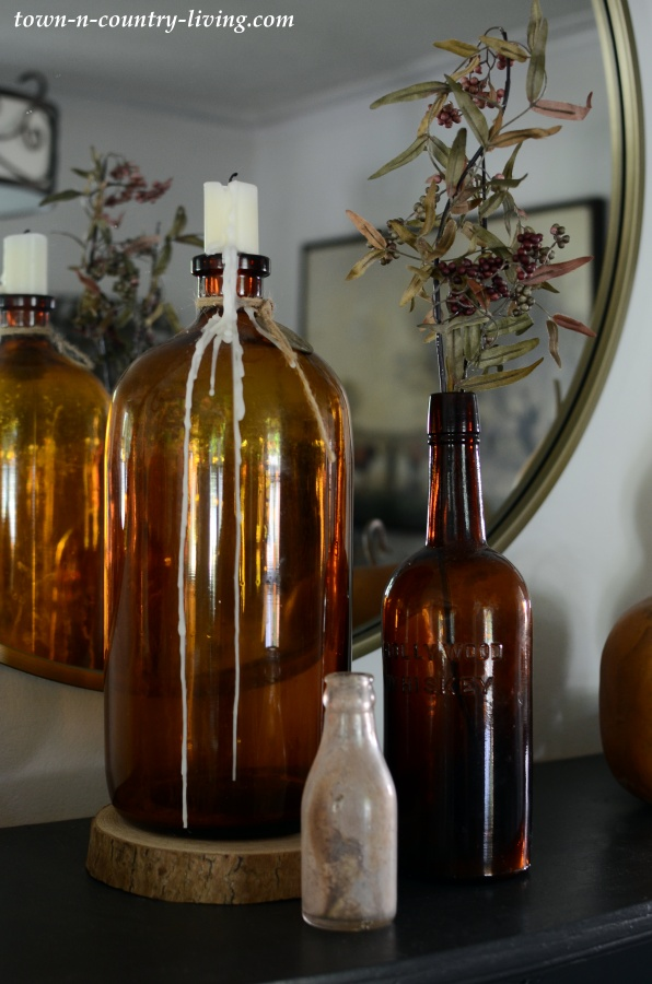 Fall Decorating with Amber Bottles and Fall Florals