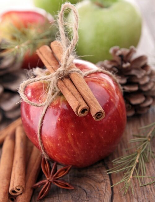 Juicy Red Apple with Cinnamon Sticks