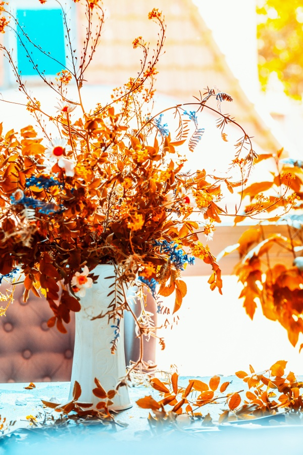 Autumn leaves bunch in vase for a cozy centerpiece or fall decoration