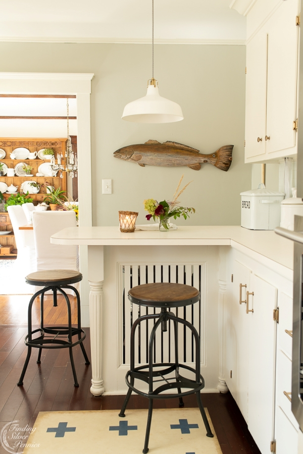 Hand Carved Fish Wall Decor in White Kitchen