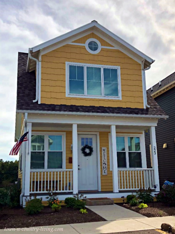 Yellow Two-Story Cottage with Front Porch at Heritage Harbor