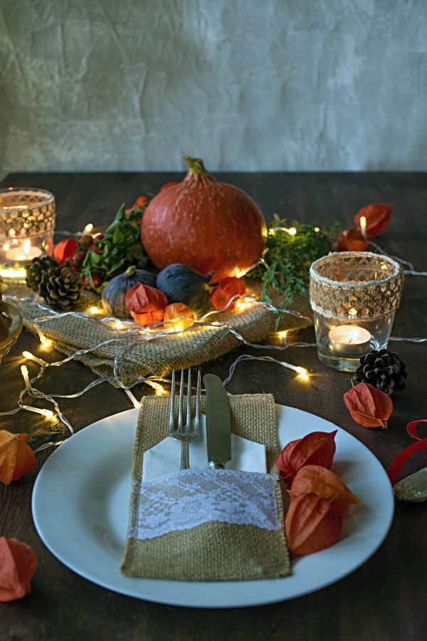 String of twinkly lights is added to fall centerpiece for evening dining