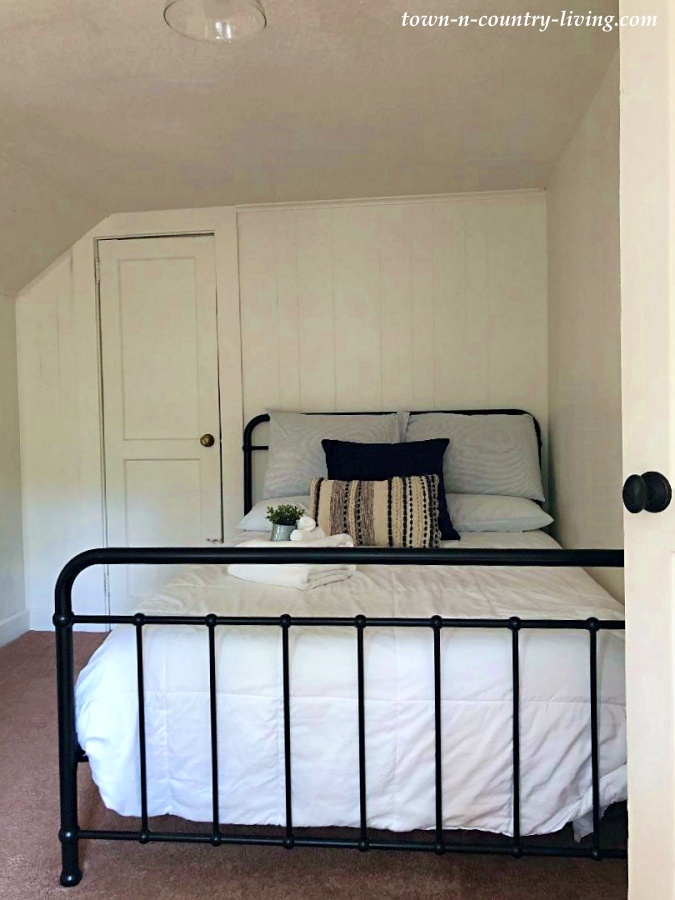 Farmhouse Bedroom with Black Metal Bed