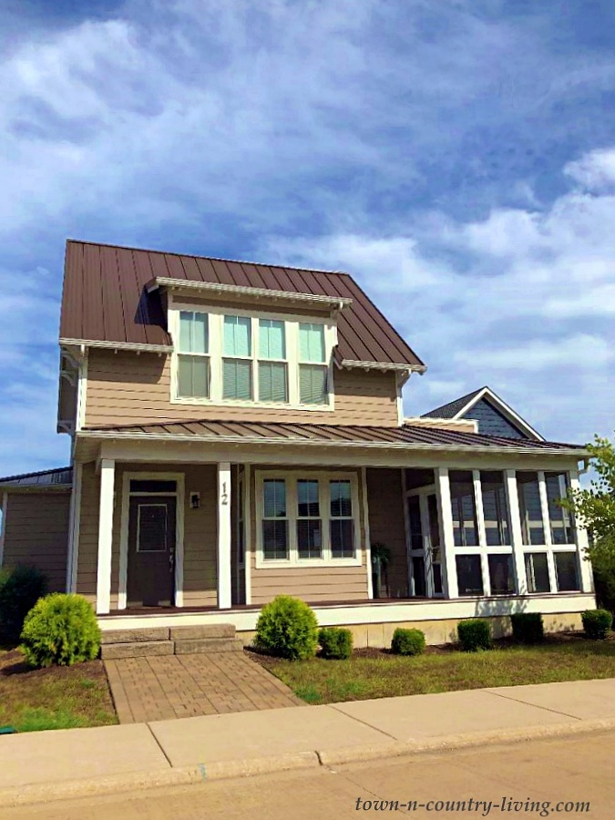Two-Story Taupe House with Screened In Porch
