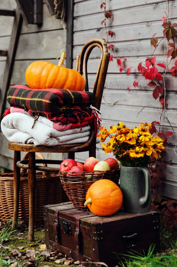 Outdoor fall decorations - pumpkins, mums, plaid blankets