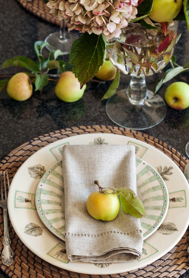 Golden apples create a table runner for this fall table setting