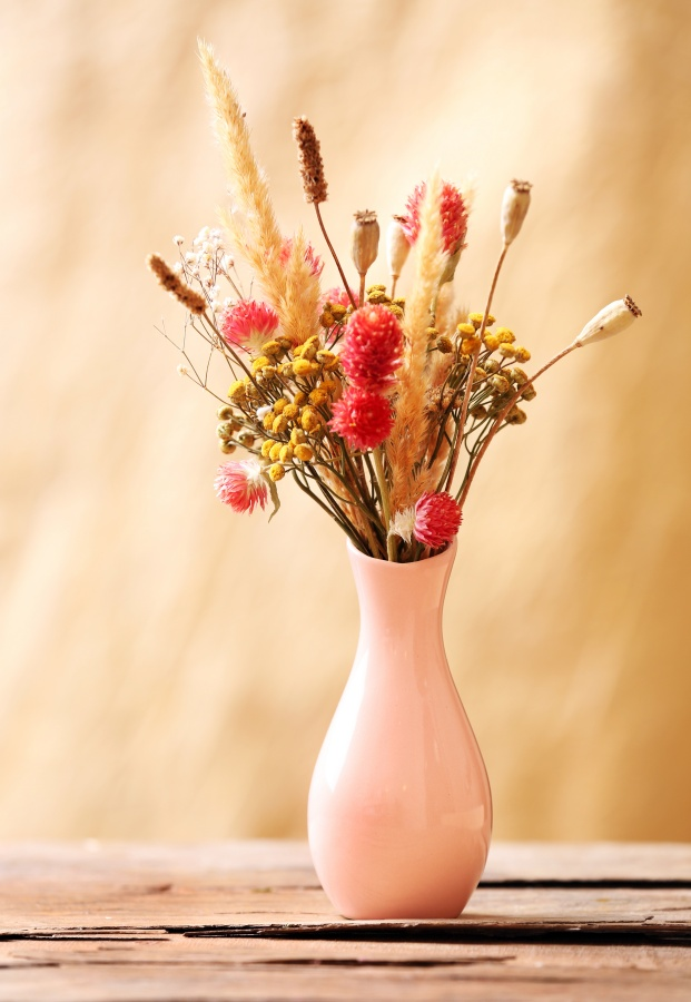Bouquet of dried flowers in pink vase