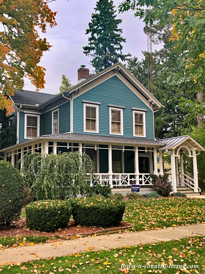 Turquoise Colored Historic Clapboard Home with Wrap Around Porch