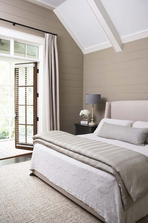 Neutral Color Scheme in Country Bedroom with Vaulted Ceiling