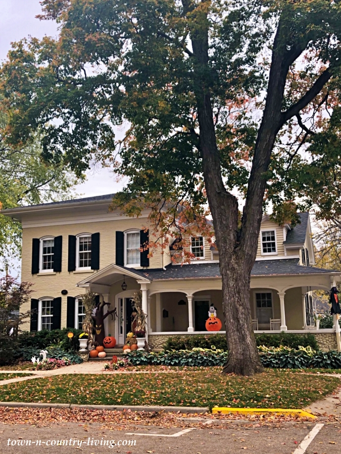 Large Stucco House with Halloween Decorations