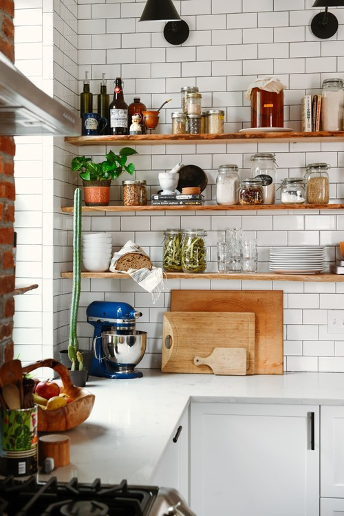 White Subway Tile and Open Wood Shelves in Eclectic Kitchen