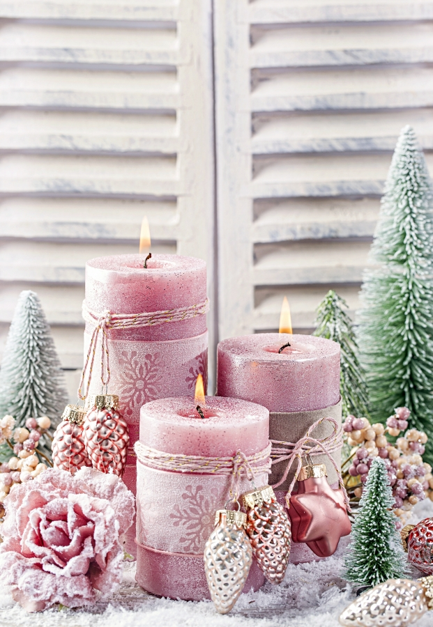 Grouping of pink candles and Christmas ornaments