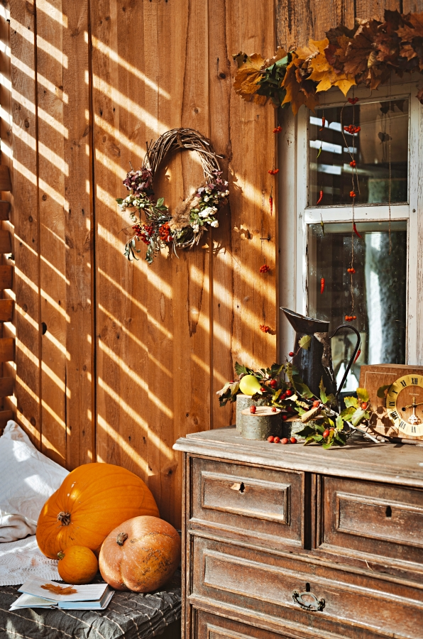 Wooden dresser on a front porch for fall decorating