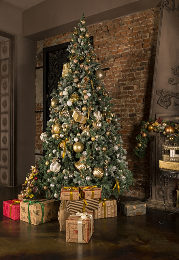 Silver and Gold Decorations on a Christmas Tree in a Rustic Living Room