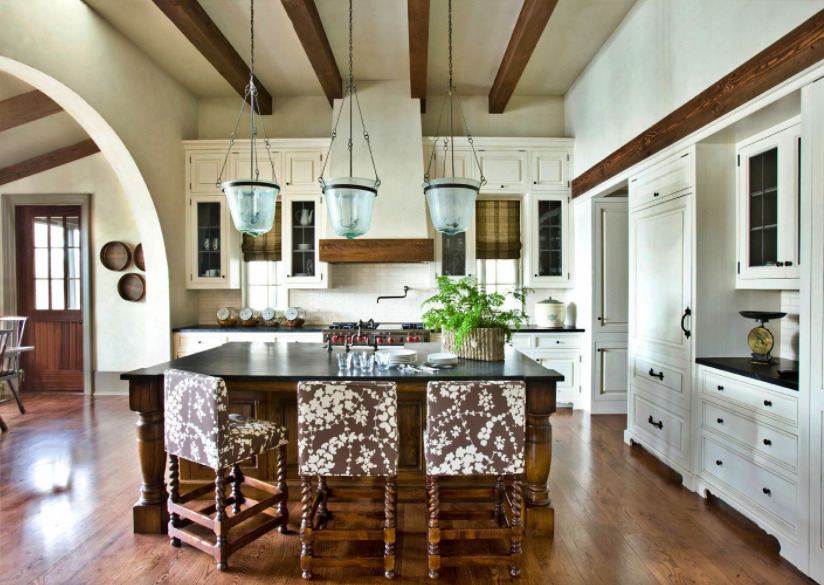 Country Style Kitchen in Earth Tones with Large Island and Wood Beam Ceiling