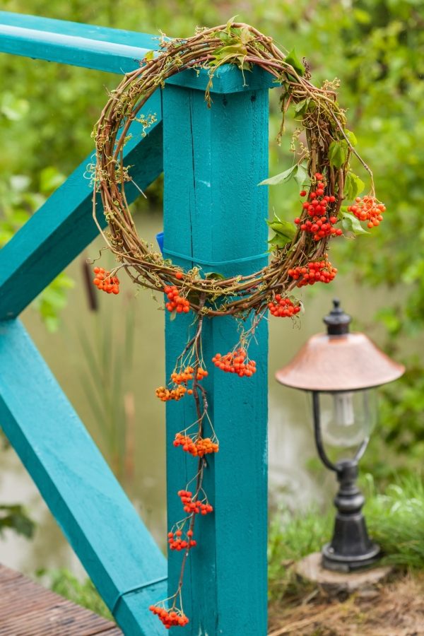 autumn wreath on turquoise porch railing