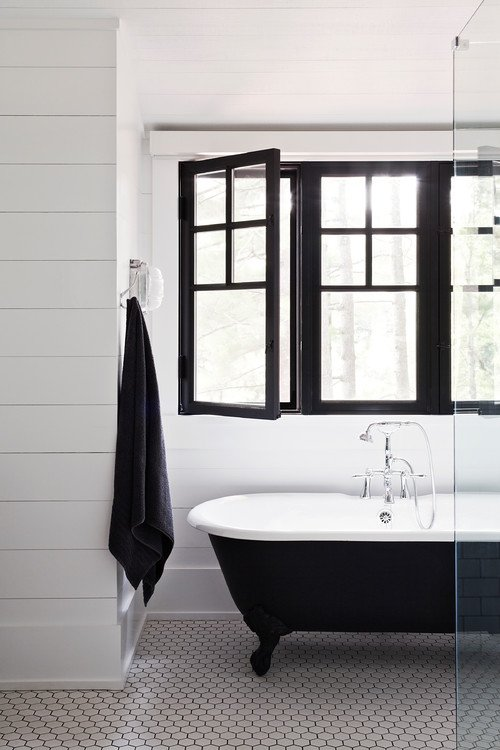 Farmhouse Style Bathroom in Black and White with Claw Foot Tub