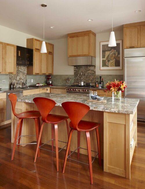 Rust-Orange Bar Stools at Wooden Kitchen Island