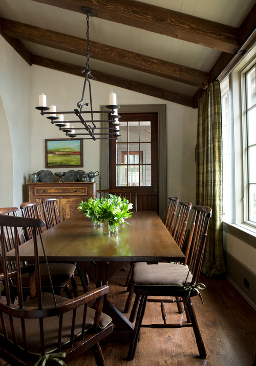 Country Style Dining Room Decorated in Earth Tones. Windsor Chairs Gather at the Table