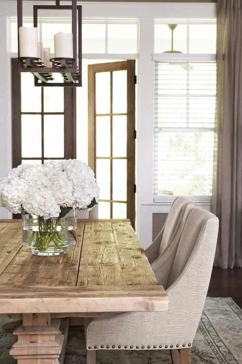 Country Style Dining Room with Neutral Decor and Farmhouse Table