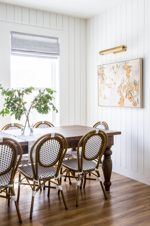 White Kitchen Dining Space with Wood Table and Chairs