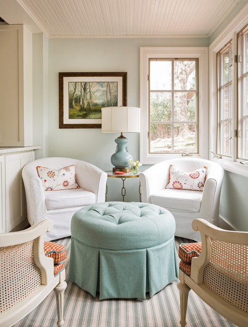 Shabby chic style sitting room with tufted ottoman