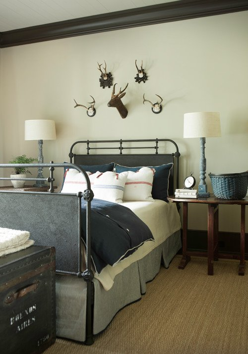 Gray and Cream Bedroom with Metal Bed and Steamer Trunk