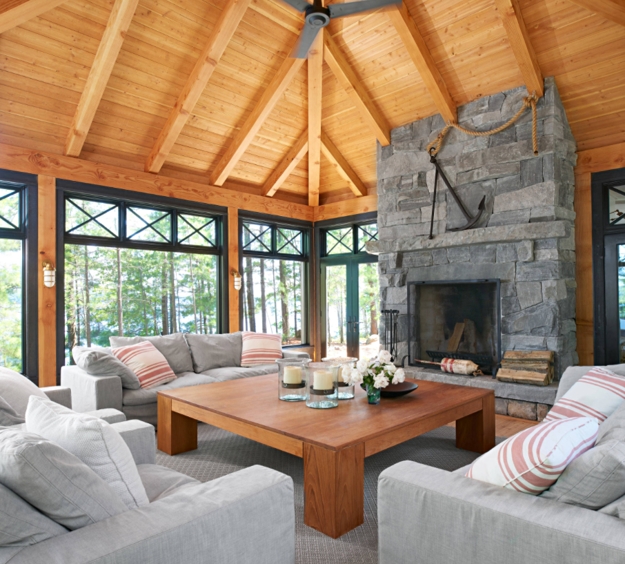 Four Season Porch with Wood Ceiling and Stone Fireplace