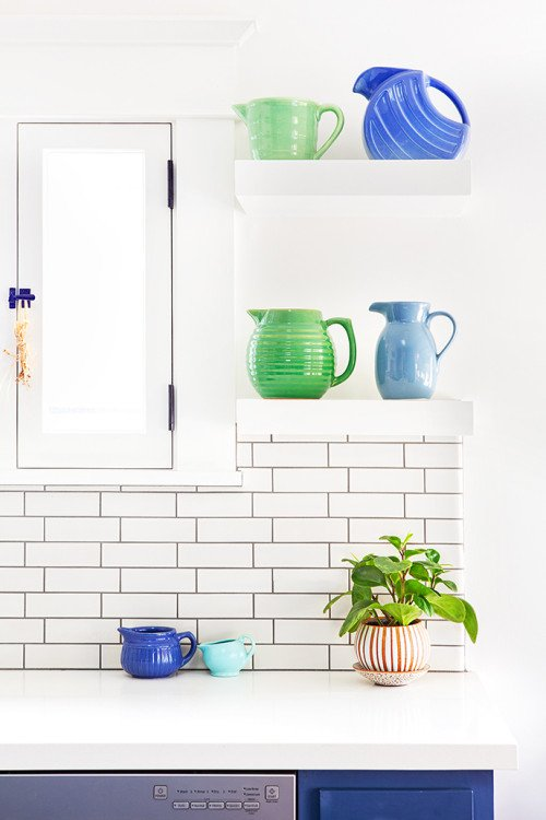 Green and blue fiesta ware in a craftsman kitchen