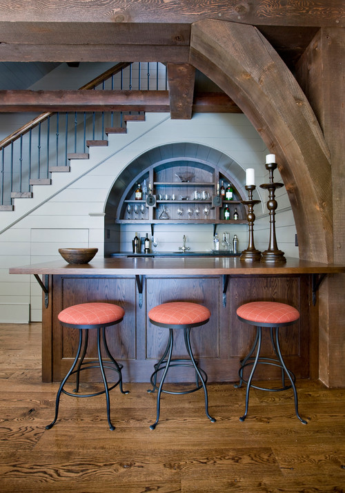 In-Home Bar with Wood Beams Looks Like European Pub
