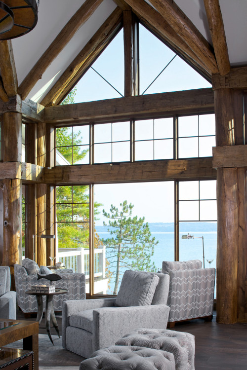 Floor-to-ceiling window with heavy wood trim in rustic lake  house