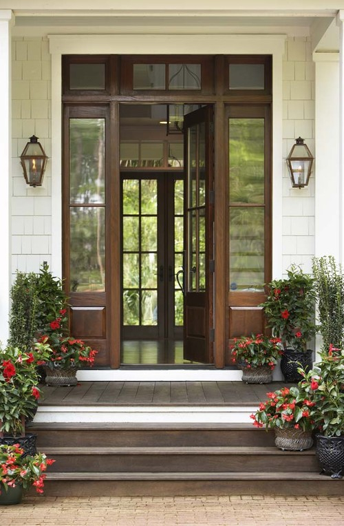 Windowed Wooden Door with Skylights at Front Entry