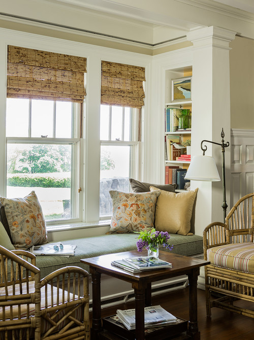 Window seat with pair of rattan chairs for conversation