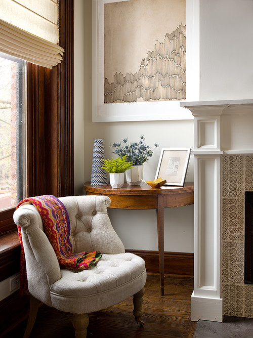 Tufted Chair in Corner by Fireplace