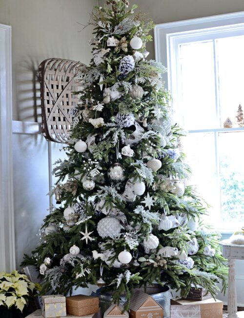 White Ornaments and Ribbons on a Green Christmas Tree