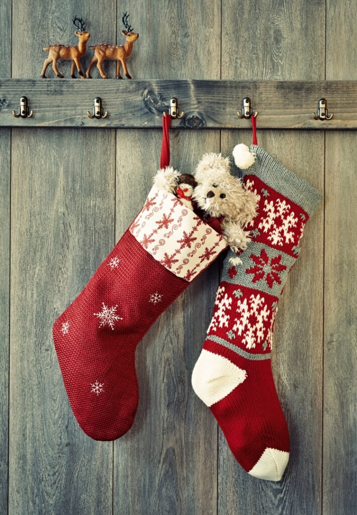 Red and White Christmas Stockings with Teddy Bear Tucked Inside